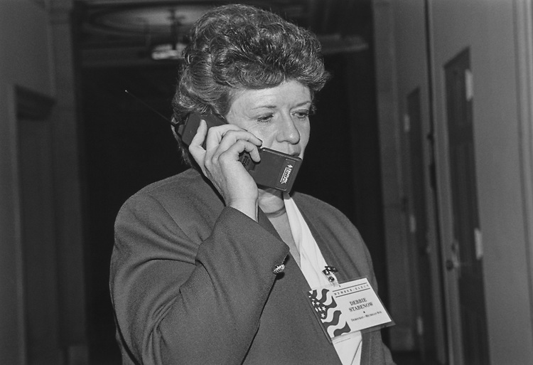 Rep.-elect Debbie Stabenow, D-Mich., on cell phone, outside a Democratic Caucus meeting  during Democratic freshman orientation on Nov. 18, 1996. (Photo by Maureen Keating/CQ Roll Call via Getty Images)