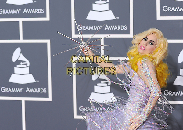 LADY GAGA (Stefani Joanne Angelina Germanotta).Arrivals at the 52nd Annual GRAMMY Awards held at The Staples Center in Los Angeles, California, USA..January 31st, 2010.grammys half length purple dress wire silver beads beaded dress sparkly spike  side sheer .CAP/RKE/DVS.©DVS/RockinExposures/Capital Pictures