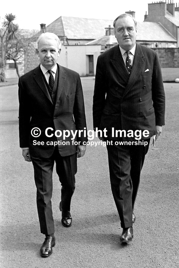 Brian Faulkner, chief executive, the power-sharing N Ireland Executive, left, meets William Whitelaw, first occupant of the office of Secretary of State for N Ireland, at Government House, Hillsborough, N Ireland. 1975041200175BF2.<br />
