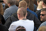 Prodigy fan with band tattoo on the back of his neck listerning to the service during the  funeral of the late Prodigy singer Keith Flint at St Marys Church in Bocking,  Essex today.
