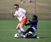 Annie Steinlage (10) of Virginia is fouled by Catrina Atanda (11) of Clemson at Klockner Stadium in Charlottesville, VA.  Virginia defeated Clemson, 3-0.