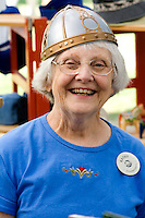 Clerk modeling replica warrior helmet of Sweden. Svenskarnas Dag Swedish Heritage Day Minnehaha Park Minneapolis Minnesota USA