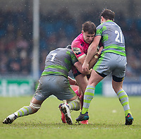 Exeter Cheifs' Ollie Devoto is tackled by 'Newcastle Falcons' Micky Young and Will Welch<br /> <br /> Photographer Bob Bradford/CameraSport<br /> <br /> Anglo Welsh Cup Semi Final - Exeter Chiefs v Newcastle Falcons - Sunday 11th March 2018 - Sandy Park - Exeter<br /> <br /> World Copyright &copy; 2018 CameraSport. All rights reserved. 43 Linden Ave. Countesthorpe. Leicester. England. LE8 5PG - Tel: +44 (0) 116 277 4147 - admin@camerasport.com - www.camerasport.com
