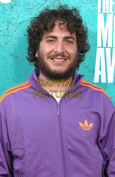 Oliver Cooper.2012 MTV Movie Awards held at the Gibson Amphitheatre, Universal City, California, USA..3rd June 2012.headshot portrait purple adidas jacket beard facial hair .CAP/ADM/SLP/LS.©Lee Sherman/Starlitepics/AdMedia/CapitalPictures.