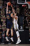 Martinas Geben (23) of the Notre Dame Fighting Irish attempts to shoot over Olivier Sarr (30) of the Wake Forest Demon Deacons during second half action at the LJVM Coliseum on February 24, 2018 in Winston-Salem, North Carolina. The Fighting Irish defeated the Demon Deacons 76-71.  (Brian Westerholt/Sports On Film)