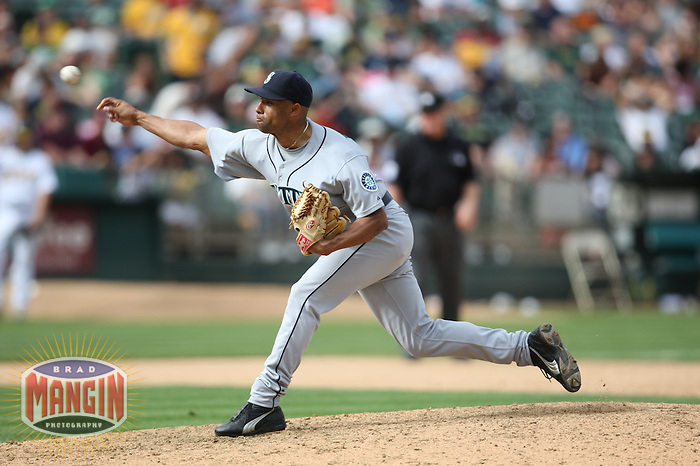 OAKLAND, CA - SEPTEMBER 20:  Miguel Batista of the Seattle Mariners pitches during the game against the Oakland Athletics at the McAfee Coliseum in Oakland, California on September 20, 2008.  The Athletics defeated the Mariners 8-7.  Photo by Brad Mangin