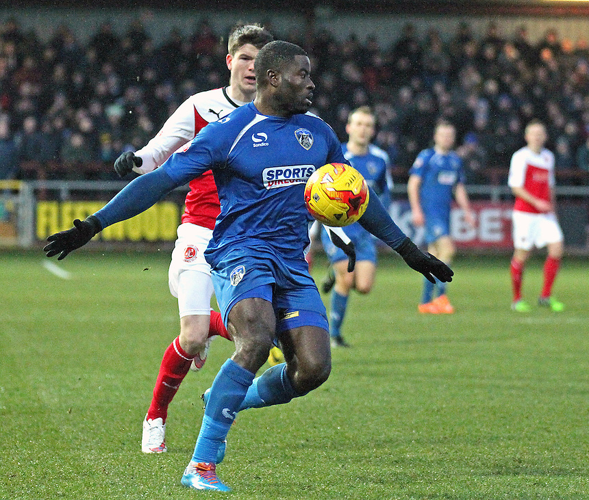 Oldham Athletic's George Elokobi shields the ball from Fleetwood Town's Liam McAlinden<br /> <br /> Photographer Rich Linley/CameraSport<br /> <br /> Football - The Football League Sky Bet League One - Fleetwood Town v Oldham Athletic - Saturday 17th January 2015 - Highbury Stadium - Fleetwood<br /> <br /> &copy; CameraSport - 43 Linden Ave. Countesthorpe. Leicester. England. LE8 5PG - Tel: +44 (0) 116 277 4147 - admin@camerasport.com - www.camerasport.com