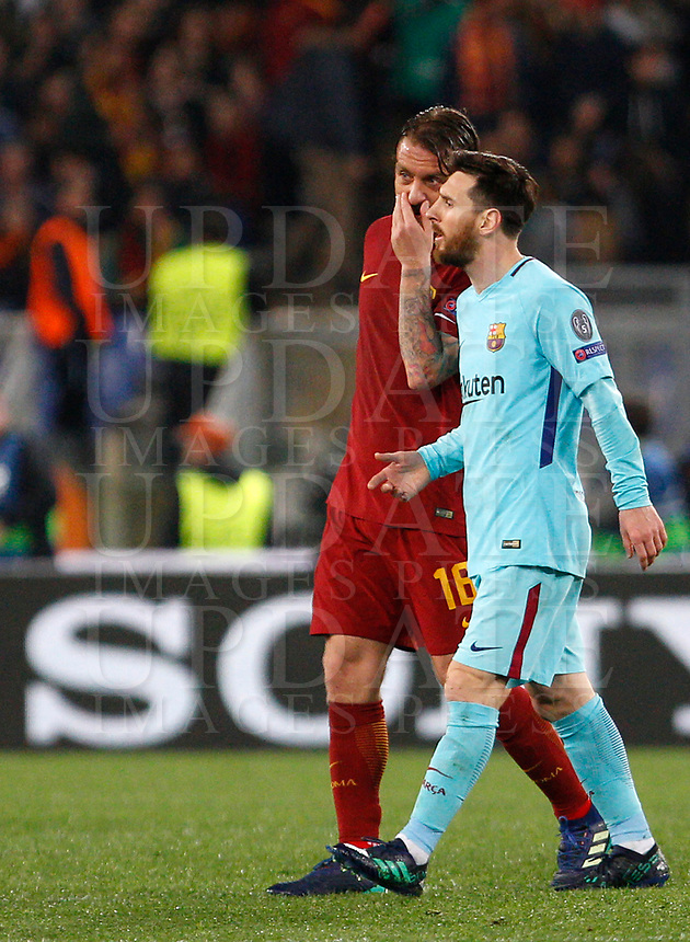 Roma s Daniele De Rossi, left, talks to FC Barcelona Lionel Messi as they leave the pitch at the end of the first half of the Uefa Champions League quarter final second leg football match between AS Roma and FC Barcelona at Rome's Olympic stadium, April 10, 2018.<br /> UPDATE IMAGES PRESS/Riccardo De Luca
