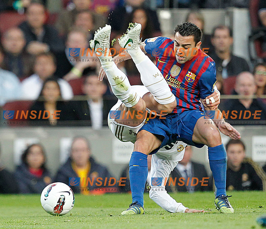 Barcelona's Xavi Hernandez and Real Madrid's Sergio Ramos.Barcellona 21/4/2012 Nou Camp.Football Calcio 2011/2012 La Liga.Barcelona Vs Real Madrid 1-2.Foto Insidefoto / Cesar Cebolla / Alfaqui.ITALY ONLY