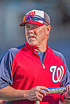 20 September 2013: Washington Nationals Batting Coach Rick Schu watches his team take batting practice prior to facing the Miami Marlins at Nationals Park in Washington, DC. The Nationals shut out the Marlins 8-0 in the second game of their 4-game series. Mandatory Credit: Ed Wolfstein Photo *** RAW (NEF) Image File Available ***