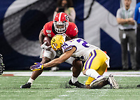 ATLANTA, GA - DECEMBER 7: Brian Herrien #35 of the Georgia Bulldogs is stopped after a short gain by Derek Stingley Jr. #24 of the LSU Tigers during a game between Georgia Bulldogs and LSU Tigers at Mercedes Benz Stadium on December 7, 2019 in Atlanta, Georgia.