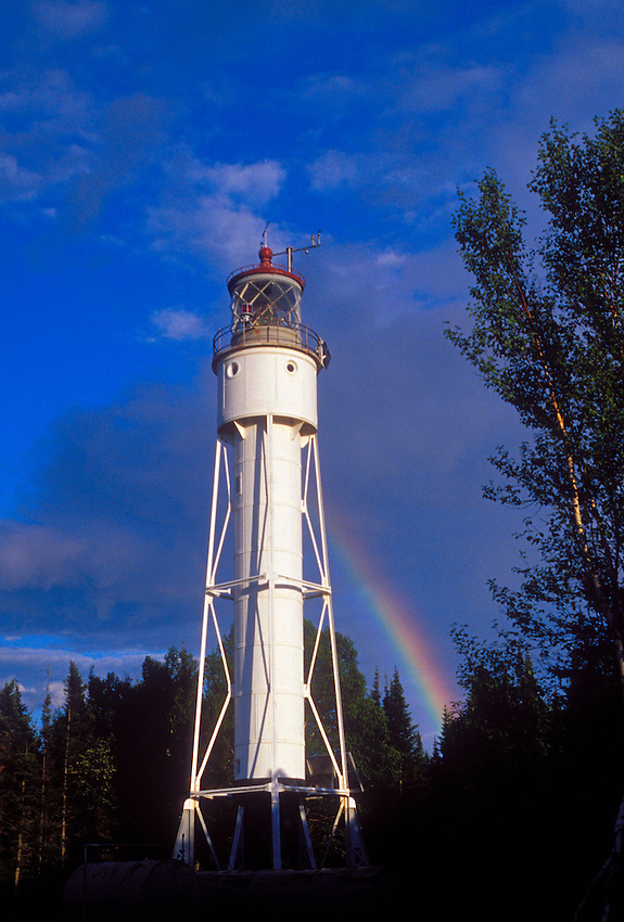 A rainbow is seen behind the Devils Island Lighthouse in Apostle Islands National Lakeshore near Bayfield, Wis.