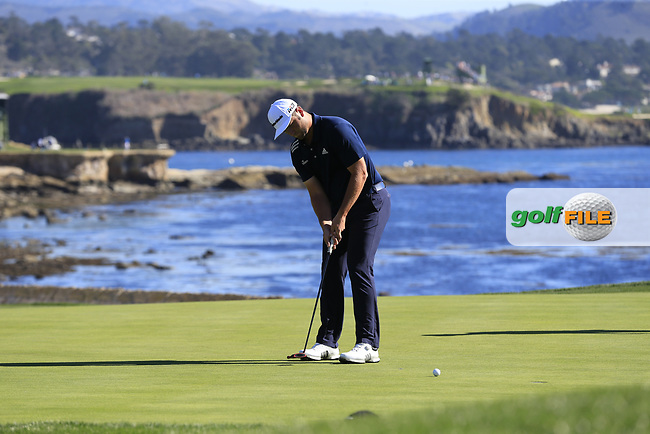 Jon Rahm (ESP) par putt on the 18th green at Pebble Beach course during Friday's Round 2 of the 2018 AT&amp;T Pebble Beach Pro-Am, held over 3 courses Pebble Beach, Spyglass Hill and Monterey, California, USA. 9th February 2018.<br /> Picture: Eoin Clarke | Golffile<br /> <br /> <br /> All photos usage must carry mandatory copyright credit (&copy; Golffile | Eoin Clarke)