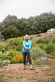USA, California, Big Sur, Esalen, a guest at the Esalen Institute volunteers and works in the garden at The Farm