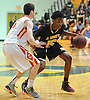 Josh Nicholas #15 of St. Anthony's, right, gets pressured by Michael McGuire #15 of Chaminade during the NSCHSAA varsity boys basketball semifinals at LIU Post on Sunday, Feb. 28, 2016. St. Anthony's won by a score of 73-54.