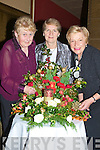 CLOURFUL: one of the many entrants of Christmas flowers at the Tralee Flower & Garden Club Gala Christmas demonstration, on Monday evening in the Grand Hotel Tralee, l-r: Carol Robins (Ballymacelligott), Kathleen Reidy (Castleisland & Chairperson of Tralee Flower & Garden Club) and Monica Healy (Tralee) ........................................ ....................