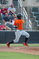 Kelvin Beltre (29) of the Augusta GreenJackets follows through on his swing against the Kannapolis Intimidators at Intimidators Stadium on May 30, 2016 in Kannapolis, North Carolina.  The GreenJackets defeated the Intimidators 5-3.  (Brian Westerholt/Four Seam Images)