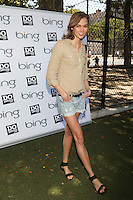 Karlie Kloss celebrates the Bing summer of Doing with dosomething.org by volunteering and restoring CITYarts Mosaic Peace Wall. Harlem, New York. July 10, 2012 © Diego Corredor/MediaPunch Inc.