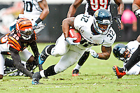 October 09, 2011:   Jacksonville Jaguars running back Maurice Jones-Drew (32) drives for extra yardage during first quarter action between the Jacksonville Jaguars and the Cincinnati Bengals played at EverBank Field in Jacksonville, Florida.  ........