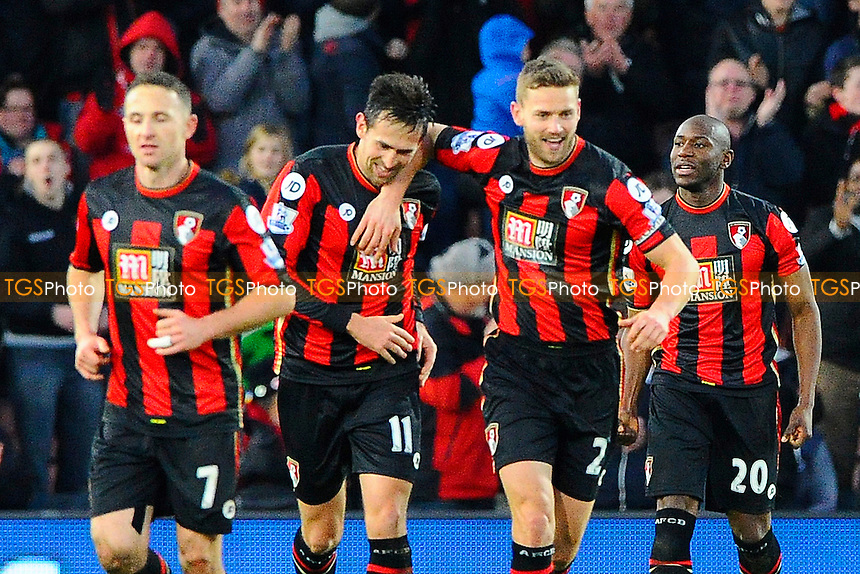 Charlie Daniels of AFC Bournemouth second left and Simon Francis of AFC Bournemouth middle celebrate the third goal scored by Benik Afobe right during AFC Bournemouth vs Norwich City at the Vitality Stadium