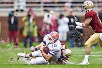 November 29, 2008:     Florida quarterback Tim Tebow (15) is sacked by Florida State safety Jamie Robinson (20) during first half non-conference game action between the University of Florida Gators  and the Florida State Seminoles at Doak Campbell Stadium in Tallahassee, Florida.   Florida defeated Florida State 45-15.