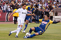 Israel Martinez (right) slide tackles Pedro Leon (left). Real Madrid defeated Club America 3-2 at Candlestick Park in San Francisco, California on August 4th, 2010.