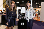 (L-R) Sisters Paige Dellavalle and Ashley Jung present their Stella Valle jewelry at the Coterie 2013 trade show presented by ENK International, at the Javits Center on September 18, 2013.