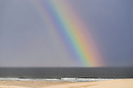 Rainbow in the sea from the sand dunes. Stockton Beach Sand dunes Worimi Conservation Lands. Anna Bay, Port Stephens, NSW, Australia