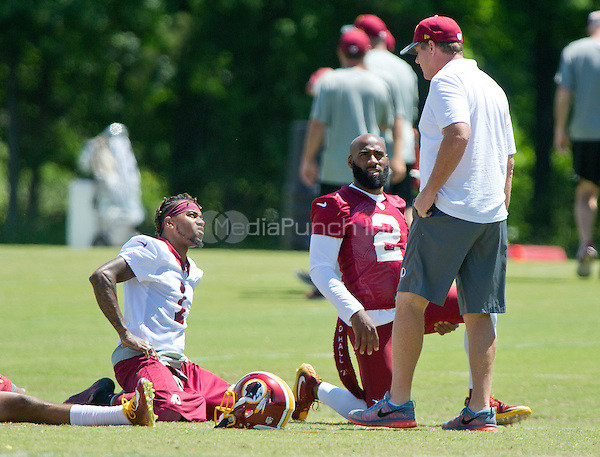 Washington Redskins wide receiver DeSean Jackson (11), wearing jersey number 1 for practice, and safety DeAngelo Hall (23), wearing jersey number 2 for practice, share conversation with head coach Jay Gruden as they participate in drills during the Veteran Minicamp at Redskins Park in Ashburn, Virginia on Tuesday, June 14, 2016.<br /> Credit: Ron Sachs / CNP/MediaPunch ***FOR EDITORIAL USE ONLY***