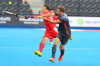 Liguang E of China and Thijs Van Dam of Netherland's compete for a high pass during the Hockey World League Quarter-Final match between Netherlands and China at the Olympic Park, London, England on 22 June 2017. Photo by Steve McCarthy.<br /> <br /> Netherlands v China at the Olympic Park, London, England on 22 June 2017. Photo by Steve McCarthy.