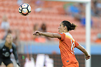 Houston, TX - Saturday June 17, 2017: Carli Lloyd attempts to gain control of a loose ball during a regular season National Women's Soccer League (NWSL) match between the Houston Dash and the Orlando Pride at BBVA Compass Stadium.