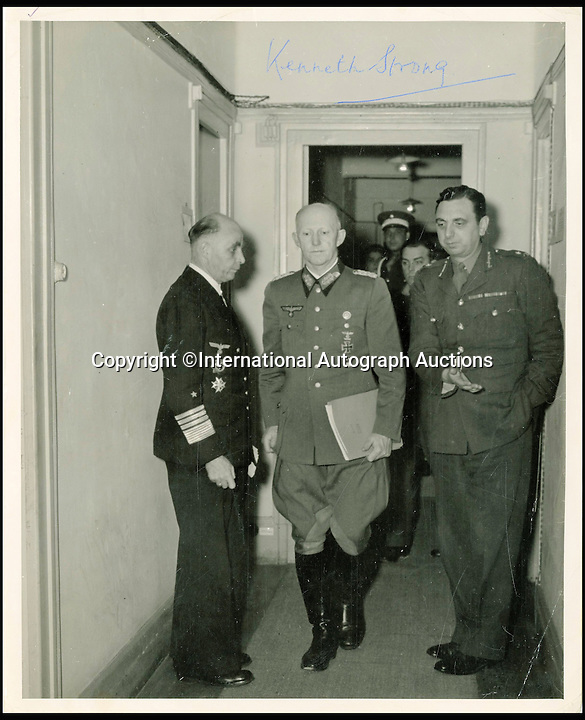 BNPS.co.uk (01202 558833)<br /> Pic: AutographAuctions/BNPS<br /> <br /> Major General Kenneth Strong accompanies Alfred Jodl, Chief of the Operations Staff of the German Armed Forces High Command, at Rheims to sign the surrender terms on behalf of the Nazi state.<br /> <br /> The final Allied intelligence message of World War Two that reports 'no enemy left to defeat' has emerged 70 years on along with an historic telex announcing the German surrender.<br /> <br /> The secret message was from the Cipher Office and dated May 8, 1945. The copy of the telex message sent from Dwight D Eisenhower to three million Allied troops was sent on the same day.<br /> <br /> Both documents are owned by the same British collector and are to be sold by International Autograph Auctions later this month.