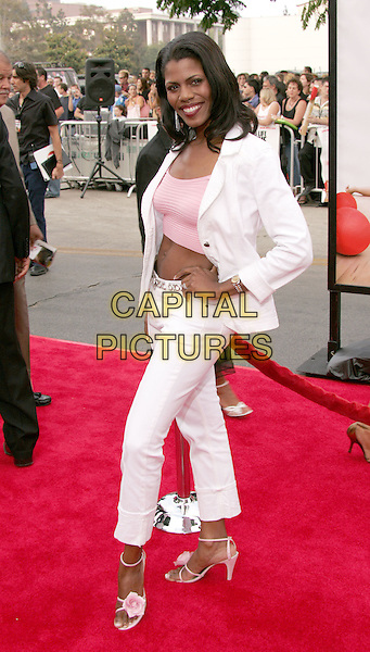 "OMAROSA MANIGAULT-STALLWORTH.The World Premiere of ""Dodgeball:A True Underdog Story"", Westwood, California.June 14th, 2004.full length, full-length,  hand on hip, pink flower sandals, crop top, belly, stomach, midriff, white trouser suit.www.capitalpictures.com.sales@capitalpictures.com.©Capital Pictures"