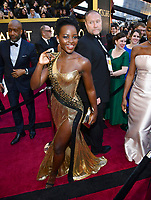 Lupita Nyong'o arrives at the Oscars on Sunday, March 4, 2018, at the Dolby Theatre in Los Angeles. (Photo by Charles Sykes/Invision/AP)
