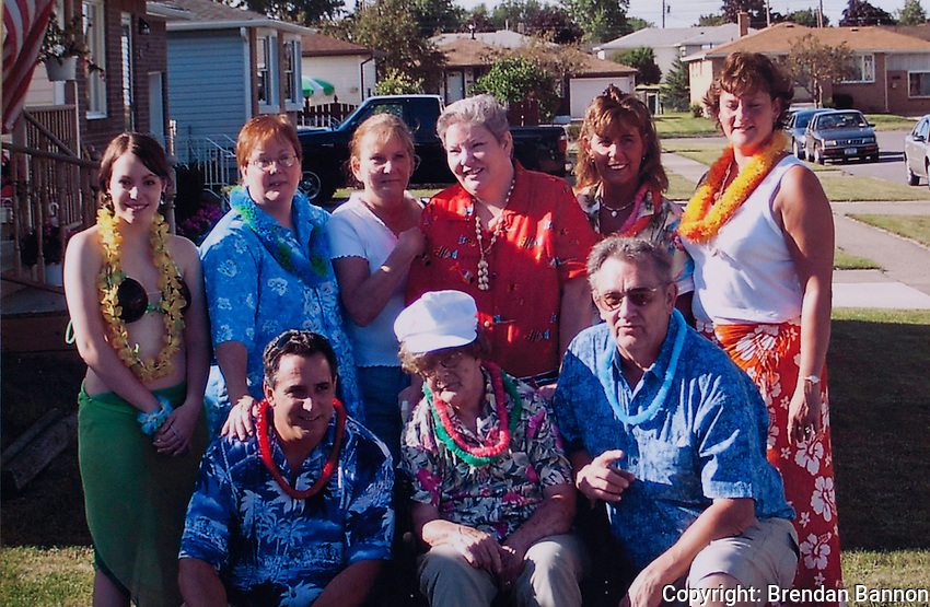 A Nachreiner family portrait taken in 2003. Top row left to right granddaughter Samantha Cooper, daughters Cherin Bauza, Tina Zelinski, Kim Glanowski, Colleen Cooper Kren, Dawn Boncal.  Bottom row left to right: Son Bill cooper, Wife Alice nachreiner and  Al Nachreiner.