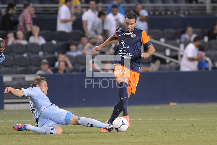 Emanuel Herrera (11) forward Montpellier  goes past the outstreched foot of Konrad Warzycha (12) defender Sporting KC..Sporting Kansas City were defeated 3-0 by Montpellier HSC in an international friendly at LIVESTRONG Sporting Park, Kansas City, KS..