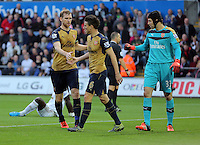 (L-R) Per Mertesacker congratulates team mate Laurent Koscielny of Arsenal for stopping Bafetimbi Gomis of Swansea from scoring a goal during the Barclays Premier League match between Swansea City and Arsenal at the Liberty Stadium, Swansea on October 31st 2015