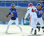 BROOKINGS, SD - NOVEMBER 17: Taryn Christion #3 from South Dakota State University scrambles away from Darin Greenfield #44 from the University of South Dakota during their game Saturday afternoon at Dana J. Dykhouse Stadium in Brookings, SD. (Photo by Dave Eggen/Inertia)