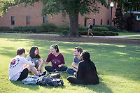 Students enjoy a conversation between classes during a warm fall afternoon on the MSU campus. Pictured, from left, is Keegan Cantrell, a freshman political science major from Hoover, Alabama; Kelly Weddle, a junior biological sciences major from Coldwater; Caitlan Maiwald, a freshman elementary education major from Prattville, Alabama; Joe Kennedy, a freshman electrical engineering major from Okimos, Michigan; and Erin Jones, a freshman art major from Meridian.<br />  (photo by Megan Bean / &copy; Mississippi State University)