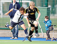 Cesar Hauet (L) of Hampstead challenges Sam Perrin during the HA Mens Cup Semi-Final between Hampstead & Westminster and Beeston at the Paddington Recreation Ground, Maida Vale on Sun March 20, 2011
