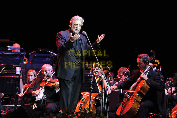 Placido Domingo .performing on stage at the O2 Arena, London, UK, July 29th, 2011..music opera singer concert live half length grey gray suit  microphone singing beard facial hair hands orchestra .CAP/MAR.© Martin Harris/Capital Pictures.