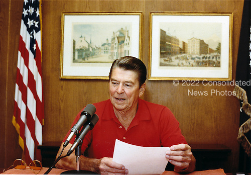 United States President Ronald Reagan gives his weekly radio address to the nation from Camp David, near Thurmont, Maryland, on Saturday, September 4, 1982.Mandatory Credit: Jack Kightlinger - White House via CNP