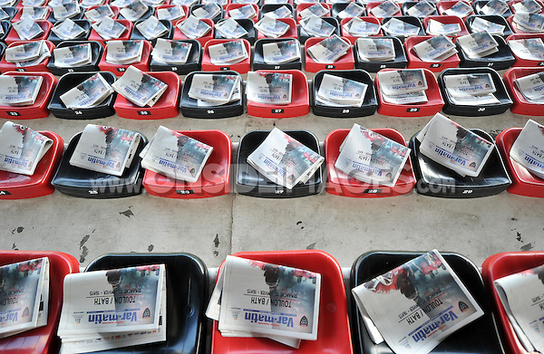 Copies of the local newspaper, advertising the match, placed on each seat at the Stade Mayol. European Rugby Champions Cup match, between RC Toulon and Bath Rugby on January 10, 2016 at the Stade Mayol in Toulon, France. Photo by: Patrick Khachfe / Onside Images