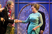 Presidential impersonator Steve Bridges shakes hands with first lady Laura Bush, with United States President George W. Bush hidden behind her.  following the performance of an American Celebration at Ford's Theatre in Washington, D.C. on June 25, 2006.<br /> Credit: Jay L. Clendenin - Pool via CNP