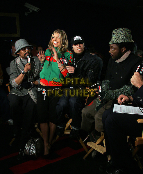 BLACK EYED PEAS - TABOO, FERGIE,  APL.DE.AP & WILL.I.AM.The 47th Annual Grammy Award Nominees Announcements. The announcements were held at The Music Box in Hollywood, California .December 7th, 2004.full length, green zip up top, cardigan, hats, hands, gesture, interview.www.capitalpictures.com.sales@capitalpictures.com.Supplied By Capital PIctures