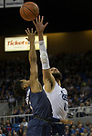 Akron guard Loren Cristian Jackson (1) shot is blocked by Nevada's forward Cody Martin (11) in the second half of an NCAA college basketball game in Reno, Nev., Saturday, Dec. 22, 2018. (AP Photo/Tom R. Smedes)