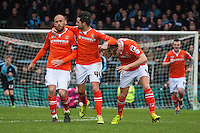 Cameron McGeehan of Luton Town (3rd left) celebrates scoring the opening goal with Alan Sheehan of Luton Town (2nd left) and Scott Cuthbert of Luton Town (left) during the Sky Bet League 2 match between Wycombe Wanderers and Luton Town at Adams Park, High Wycombe, England on 6 February 2016. Photo by Claudia Nako.