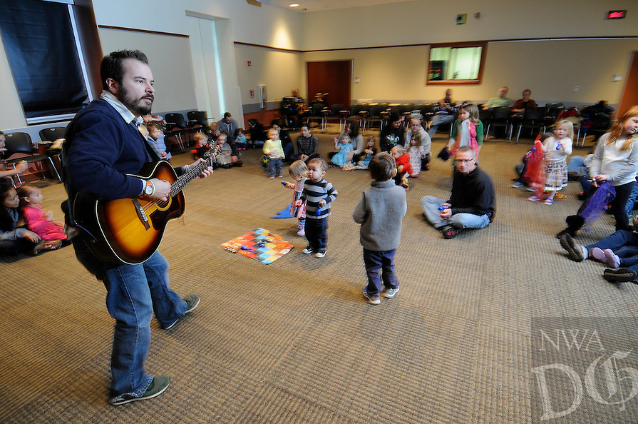 "NWA Media/ J.T. Wampler - Jeremy Babcock of Chicago performs ""She'll be Coming Round the Mountain When She Comes"" Saturday Dec. 27, 2014 at the Fayetteville Public Library. Babcock also performs with the band Dreamtree Shakers."