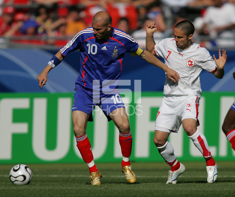 Zinedine Zidane (10) of France battles Ricardo Cabanas (7) of Switzerland battles for ball. France and Switzerland played to a 0-0 tie in their FIFA World Cup Group G match at the Gottlieb-Daimler-Stadion, Stuttgart , Germany, on Tuesday, June 13, 2006.