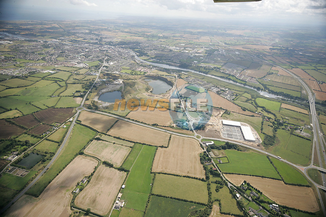 Aerial photo showing the M1 at the Slane interchange looking South East across the Boyne.  The M1 Business Park and Drogheda and surrounding areas are also in view. 02/09/05...Photo NEWSFILE/Fran Caffrey.(Photo credit should read Fran Caffrey/NEWSFILE)....This Picture has been sent you under the condtions enclosed by:.Newsfile Ltd..The Studio,.Millmount Abbey,.Drogheda,.Co Meath..Ireland..Tel: +353(0)41-9871240.Fax: +353(0)41-9871260.GSM: +353(0)86-2500958.email: pictures@newsfile.ie.www.newsfile.ie.FTP: 193.120.102.198...This picture is from Fran Caffrey@newsfile.ie